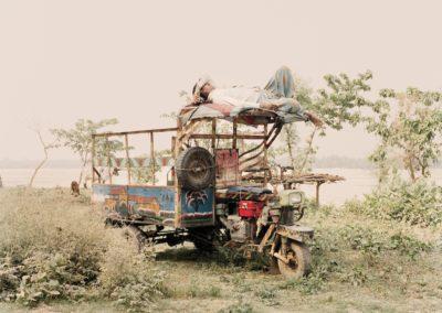 Resting on a tuk tuk, Bangladesh.